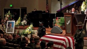 The casket of Lancaster Sgt. Steve Owen is seen during his memorial service on Oct. 13, 2016. (Credit: Pool)