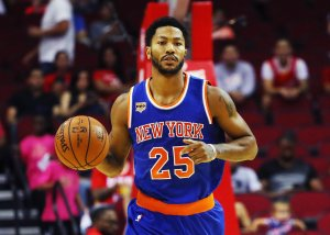 Derrick Rose of the New York Knicks takes the basketball up the court during their game against the Houston Rockets at the Toyota Center on Oct. 4, 2016, in Houston, Texas. (Credit: Scott Halleran/Getty Images)