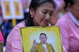 Supporters of Thailand's King Bhumibol Adulyadej react as they pray at Siriraj Hospital, where the king is being treated in Bangkok on October 13, 2016. (Credit: MUNIR UZ ZAMAN/AFP/Getty Images)