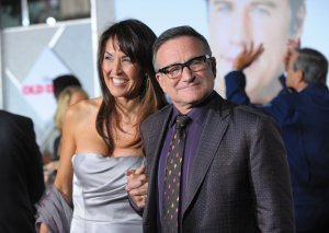 """Actor Robin Williams, right, and Susan Schneider Williams arrive at the premiere of """"Old Dogs"""" at the El Capitan Theatre on Nov. 9, 2009 in Hollywood, California. (Credit: Jason Merritt/Getty Images)"""