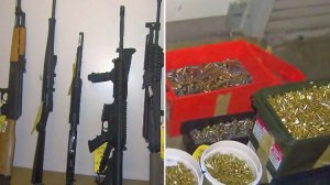 Photos displayed at an LAPD news conference show ammunition and firearms allegedly found at the home of Mark Feigin in October 2016. (Credit: KTLA)