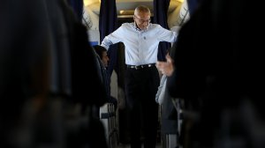 John Podesta, campaign chairman for Hillary Clinton, aboard the the Clinton campaign plane while traveling to Raleigh Durham International Airport on September 27, 2016. (Credit: Justin Sullivan/Getty Images)
