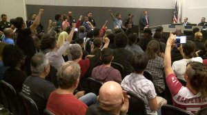 "Protesters shout ""shut it down"" at a Los Angeles Police Commission meeting on Oct. 4, 2016, (Credit: KTLA)"
