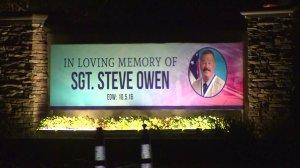 A sign honoring slain Sgt. Steve Owen is seen outside a church in Lancaster on Oct. 13, 2016. (Credit: KTLA)