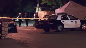 Authorities investigate a fatal shooting in Pacoima on Oct. 20, 2016. (Credit: KTLA)
