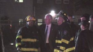 Mike Pence poses for a quick photo with firefighters who responded after his campaign plane skidded off the runway at LaGuardia Airport on Oct. 27, 2016. (Credit: pool via CNN)