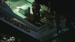 Two people were rescued after a boat crashed and capsized near Marina del Rey on Oct. 12, 2016. (Credit: KTLA)