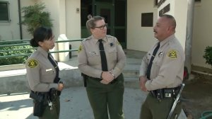 Deputies Jacqueline Morales (left) and Orlando Macias (right) rescued a couple in their late 80s from a burning home in San Gabriel on Oct. 15, 2016. (Credit: KTLA)