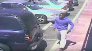 Surveillance video released by the LAPD appears to show a man with a gun prior to a fatal police shooting in South Los Angeles on Oct. 1, 2016.