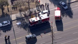 Police and firefighters respond to a shooting in Sylmar on Oct. 25, 2016. (Credit: KTLA)