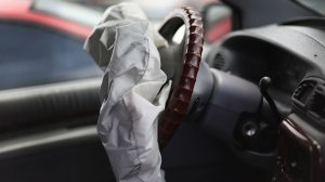 A deployed Takata airbag is seen in a Chrysler vehicle at a salvage yard in Florida on May 22, 2015. (Credit: Joe Raedle/Getty Images)