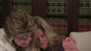 Gloria Allred comforts Summer Zervos at a news conference at Allred's L.A. office on Oct. 14, 2016. (Credit: CNN)