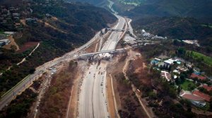 """Construction crews demolish the old Mulholland Bridge over the 405 Freeway, which was closed to traffic in both directions during """"Carmageddon"""" in 2012. (Credit: Gina Ferazzi/Los Angeles Times)"""