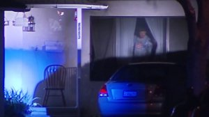 A man barricaded himself inside his Pico Rivera home for 26 hours and surrendered on Monday, Nov. 14. (Credit: KTLA)