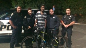 Jourdan Duncan takes a picture with officers and his new bike in an image posted on GoFundMe.