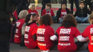 """""""Fight for 15"""" protesters sit in the street in downtown Los Angeles on Nov. 29, 2016. (Credit: KTLA)"""