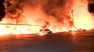 A massive fire burned at a Newport Beach storage facility early Nov. 11, 2016. (Credit: OnScene.TV)
