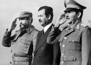 Iraqi vice-president Saddam Hussein (C), stands with Cuban President Fidel Castro (L) and Defense minister General Raul Castro (R), 30 January 1979 in Havana, during his visit to Cuba.  (Credit:AFP/Getty Images)