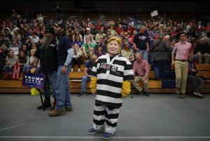 Tristan Clancy, 10, of South Saint Paul, Minnesota, dresses as Democratic presidential nominee Hillary Clinton in prison garb while attending a rally for Republican presidential nominee Donald Trump  Nov. 1, 2016, in Eau Claire, Wisconsin. (Credit: Chip Somodevilla/Getty Images)