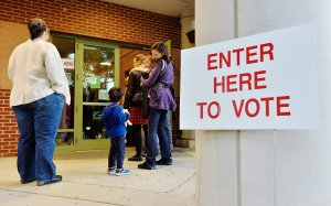 A voting line trails outside of a precinct as voters wait to get in on November 8, 2016 in Durham, North Carolina. (Credit: Sara D. Davis/Getty Images)
