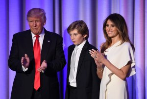 U.S. President-elect Donald Trump arrives with his son Baron and wife Melania at the New York Hilton Midtown in New York on Nov. 8, 2016. (Credit: Saul Loeb/AFP/Getty Images)