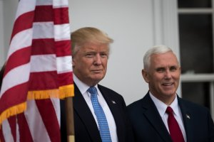 President-elect Donald Trump and vice president-elect Mike Pence listen to a question from the press regarding the musical 'Hamilton' before their meeting with investor Wilbur Ross at Trump International Golf Club, November 20, 2016 in Bedminster Township, New Jersey. (Credit: Drew Angerer/Getty Images)