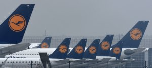 Airplanes of German airline Lufthansa are parked at the Franz-Josef-Strauss airport in Munich, southern Germany, on Nov. 24, 2016. (Credit: CHRISTOF STACHE/AFP/Getty Images)