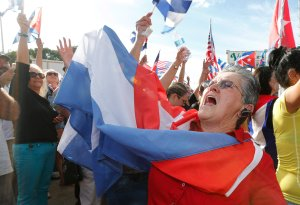 Cuban Americans celebrate in the streets of Miami's Little Havana the death of Cuban dictator Fidel Castro on November 26, 2016. (Credit: Rhona Wise/AFP/Getty Images)
