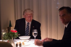 U.S. President-elect Donald Trump dines with Mitt Romney at Jean-Georges restaurant at Trump International Hotel and Tower in New York on Nov. 29, 2016. (Credit: Bryan R. Smith / AFP / Getty Images)