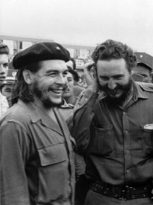 Photo taken in the 60's of then Cuban Prime Minister Fidel Castro(R) during a meeting next to Argentine guerrilla leader Ernesto Che Guevara. (Credit:AFP/Getty Images)