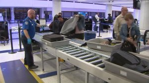 Passengers try out the new automated TSA security checkpoint at LAX on Nov. 18, 2016. (Credit: KTLA)