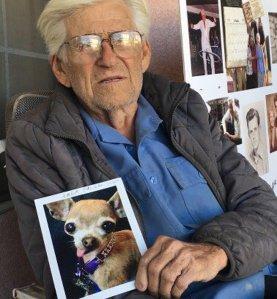 Roger LeClair holds up a photo of Lola on Nov. 18, 2016. (Credit: KTLA)