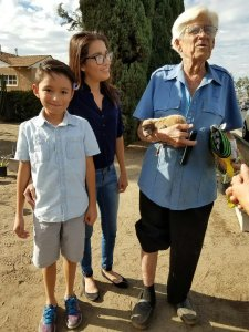 Cynthia Godfrey, center, and her son stand with Roger LeClair and Lola as they are reunited Nov. 19, 2016. (Credit: KTLA)