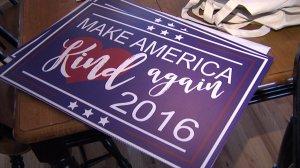 "A Sacramento woman's ""Make America Kind Again"" signs have garnered international attention. (Credit: KTXL)"