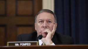 Republican US Representative from Kansas Mike Pompeo listens as former US Secretary of State and Democratic Presidential hopeful Hillary Clinton testifies before the House Select Committee on Benghazi on Capitol Hill in Washington, DC, October 22, 2015. (Credit: Saul Loeb/AFP/Getty Images)