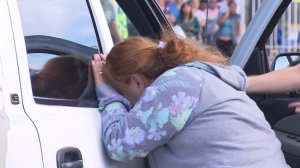 The mother of a teen cyclist arrives at the scene where her son was killed in Pacoima on Nov. 15, 2016. (Credit: KTLA)
