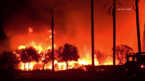 A pallet yard caught fire in Perris on Nov. 18, 2016. (Credit: OnScene.TV)