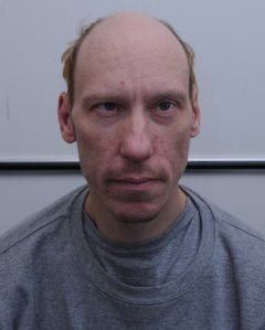 Stephen Port, 41, is shown in a booking photo. (Credit: CNN)