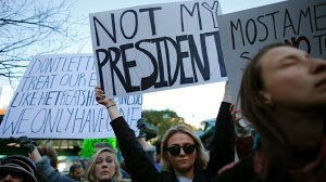 A woman holds a poster during a rally against President-elect Donald Trump in Union Square on November 12, 2016, in New York. (Credit Kena Betancur /AFP/Getty Images)