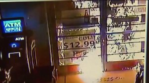 Surveillance video shows Sunny Liquor and Market recently being set on fire. (Credit: KTLA)