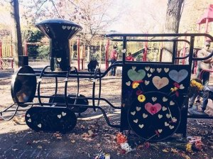Playground equipment at Adam Yauch Park in New York has since been painted over and hearts and flowers have been placed on it. (Credit: CNN)