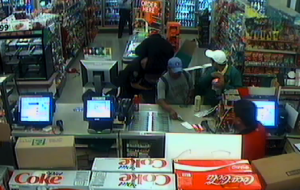 A surveillance photo released by the Santa Monica Police Department shows an altercation between an officer and a suspect inside a 7-11 on Oct. 28, 2016)