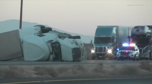 A big rig overturned in gusty winds on Highway 395 in the Pearsonville area on Nov. 16, 2016. (Credit: High Desert News)