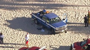 A beachgoer was hospitalized after being run over by a county truck at Venice Beach on Nov. 4, 2016. (Credit: KTLA)