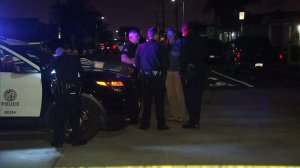 Los Angeles Police officials investigate a triple shooting in Wilmington on Nov. 28, 2016. (Credit: KTLA)