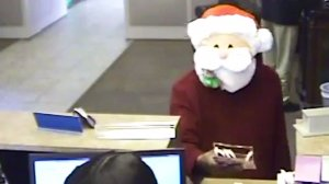 A man in a Santa mask is seen in an image provided by the Memphis Police Department as he robbed a bank on Dec. 21, 2016.