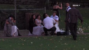 People are seen at Penn Park in Whittier after a tree fell on a wedding party on Dec. 18, 2016. (Credit: OnScene.TV)