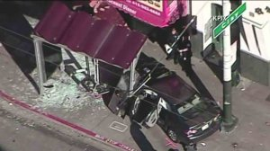 Ten people were hurt, including five with major injuries, after a car plowed into a bus stop in San Francisco on Dec. 16, 2016. (Credit: KPIX)