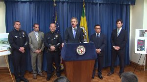 City Attorney Mike Feuer discusses legal actions against a white supremacist gang at a news conference at City Hall on Dec. 13, 2016. (Credit: KTLA)
