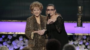Carrie Fisher presents her mother, Debbie Reynolds, the Life Achievement Award at the 21st Screen Actors Guild Awards at the Shrine Auditorium in Los Angeles on Jan. 25, 2015. (Credit: Robert Gauthier / Los Angeles Times)